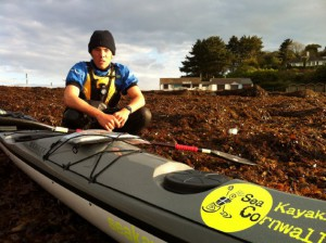 Joe Leach at the start of Round Britain 2012 paddling