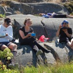 Paddlare äter lunch Långö vid Smögen