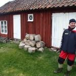 Hus och padlare på Hättan